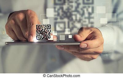 tablet computer Qr code scan - business man hand using...