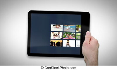 Tablet computer showing families relaxing together