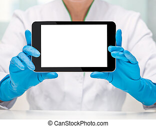 Tablet computer in the hands of the doctor with gloves