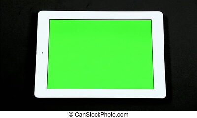 A finger taps and swipes on a screen touch to simulate interacting with a tablet computer device. Many different options of swipes and taps and pinches and pulls so you have a lot of flexibility with your compositions. Green screen ready for chroma key.