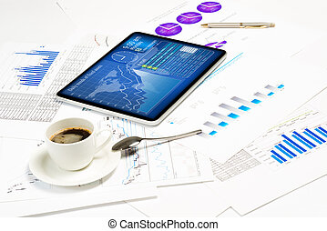 tablet, financial documents and a cup of coffee
