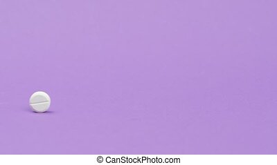Tablet is rolling on a purple background.