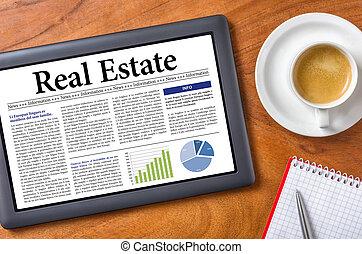 Tablet on a desk - Real Estate