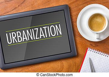 Tablet on a desk - Urbanization