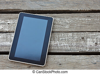 tablet on wood background