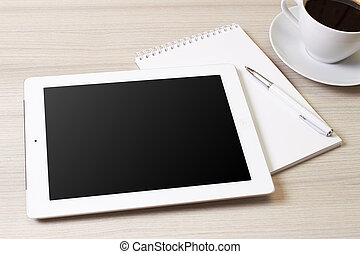 Tablet pc alike ipad with blank screen and pen over table,...