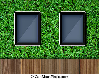 Tablet pc computer on grass