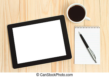 Tablet PC, cup of coffee with office supplies