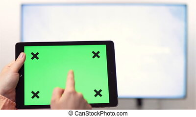 Tablet pc green screen and smart TV - Woman watches...