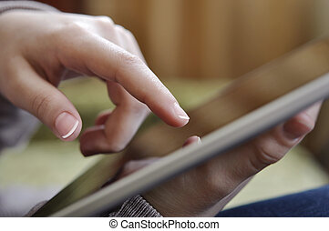 tablet pc in female hand