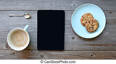 Tablet pc looking like ipad mini on table with coffee cup