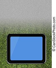Tablet pc on soccer grass field