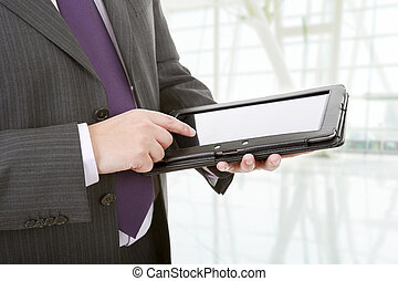 tablet pc - businessman using touch pad, close up shot on...