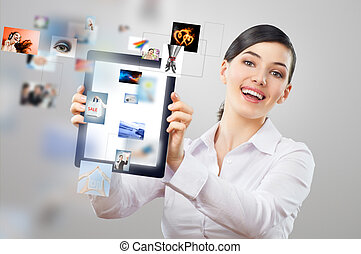 tablet pc - a woman holding a tablet pc