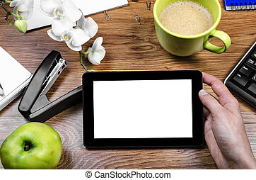 Tablet pc - Tablet with an empty screen in hands close to a...