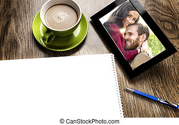 Tablet pc with a photo of a couple in love