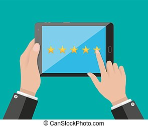 tablet pc with five star rating on screen - Hand holding and...