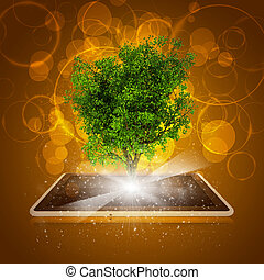 Tablet pc with magical green tree and rays of light