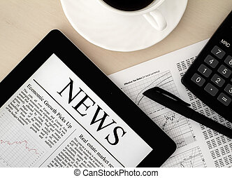Tablet PC With News On Desk - Desktop with a Tablet PC,...