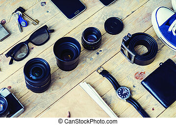 Tablet, phone, album, glasses, camera, lenses, gumshoes and watches