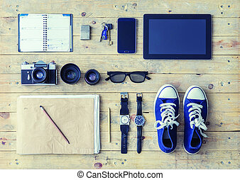 Tablet, phone, album, glasses, camera, lenses, gumshoes and watches.