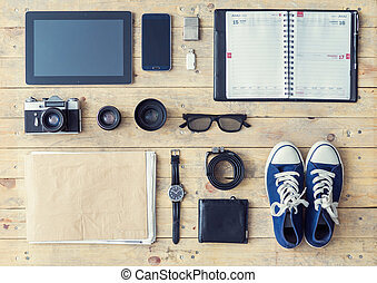 Tablet, phone, album, glasses, camera, lenses, wallet, gumshoes, usb storage and watches.