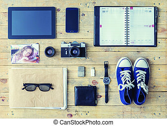 Tablet, phone, album, glasses, wallet, gumshoes, usb storage and watches.