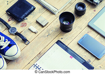 Tablet, phone, diary, lenses, gumshoes and watches