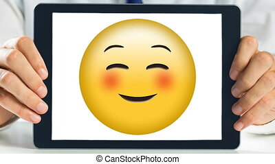 Tablet showing happy Smiley Video