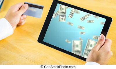 Tablet showing raining dollar bills video