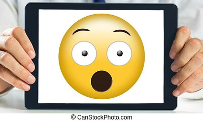 Tablet showing shocked animated smiley video