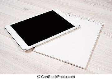 Tablet - White digital tablet with pen and notebook on the...