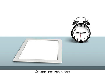 Tablet with alarm clock on desk