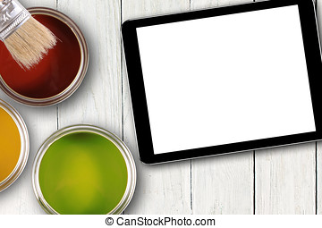 tablet with blank screen and colorful paint cans