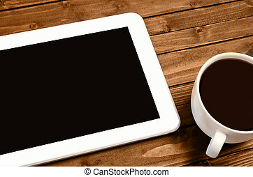 Tablet with cup of coffee