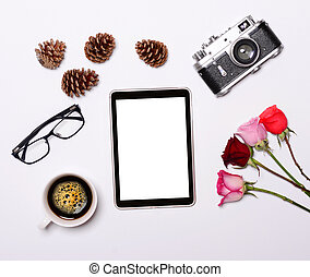 Tablet with empty screen camera and other retro objcects around it on white background - Trendy minimal flat lay concept