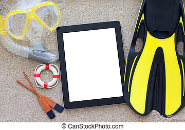 tablet with isolated screen lying on the sand
