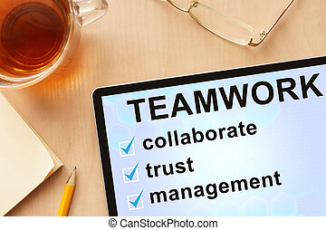 Tablet with word teamwork.