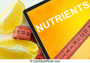 nutrients - Tablet with words nutrients and measuring tape...