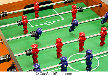 Tabletop foosball game with red and blue figures