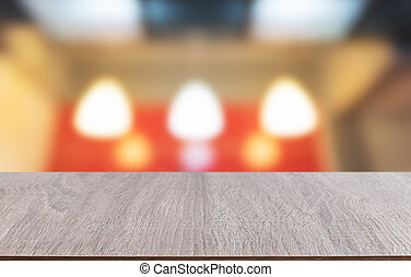 Tabletop made of wood with the blurred background of lighting bokeh.