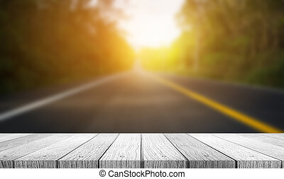tabletop - Blurred of road to the nature at sunset time with...