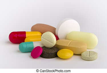 tablets and capsules, isolated on white background, close up...