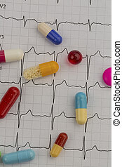 tablets on an ekg - several tablets are on an ekg. symbol...