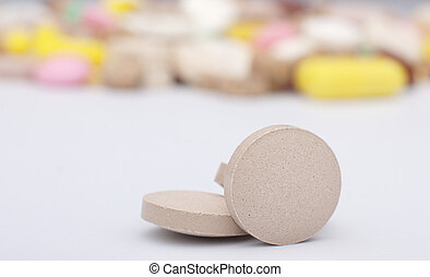 tablets - the tablets and heap of colored pills