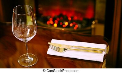 Tableware and wineglass for wine lies on table in restaurant