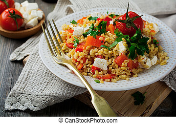 Tabula. Bulgur with baked pepper, tomato and feta cheese on ...