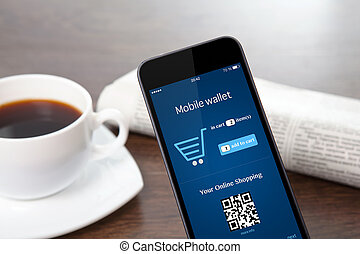 tach phone with mobile wallet onlain shopping on the screen on a table at a businessman in office