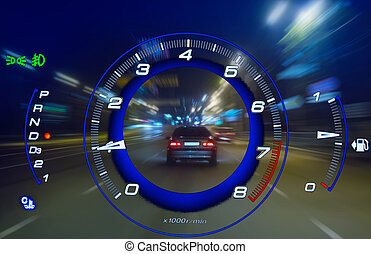 Tachometer against the background of night traffic on a city street.