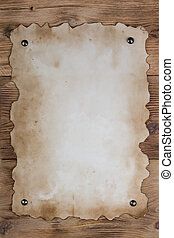 Old paper tacked to a wood wall